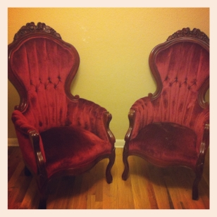 2 plush upholstered red tufted chairs