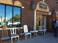 mismatched vintage chairs outside of Anna Be